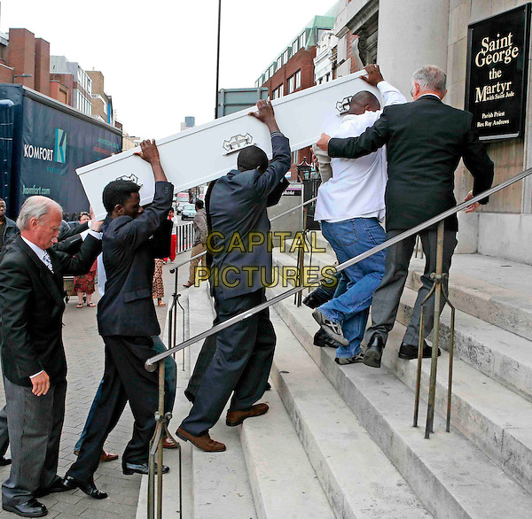 DAVID IDOWU'S FUNERAL.14 year-old David Idowu is London's 19th teenage knife victim this year..The funeral of stab victim David Idowu at St George The Martyr church,  Borough High Street. The procession was started at Great Dover Street and moved along to the church, London, England.August 20th, 2008.murder coffin jeans denim mourners carrying lifting .CAP/FIN.©Steve Finn/Capital Pictures.