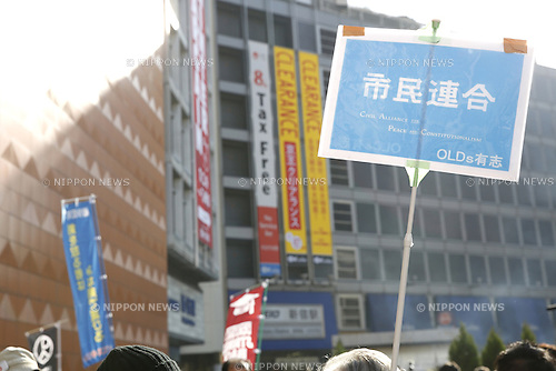 Demonstrators attend a rally against new security legislation at Tokyo's Shinjuku district, Japan on January 5, 2016. The Civil Alliance for Peace and Constitutionalism, comprised of members from SEALDs and other organizations, held a new year public rally to demand repeal of contentious security laws and to call on opposition parties to ally in this summer's upper house election. (Photo by AFLO)
