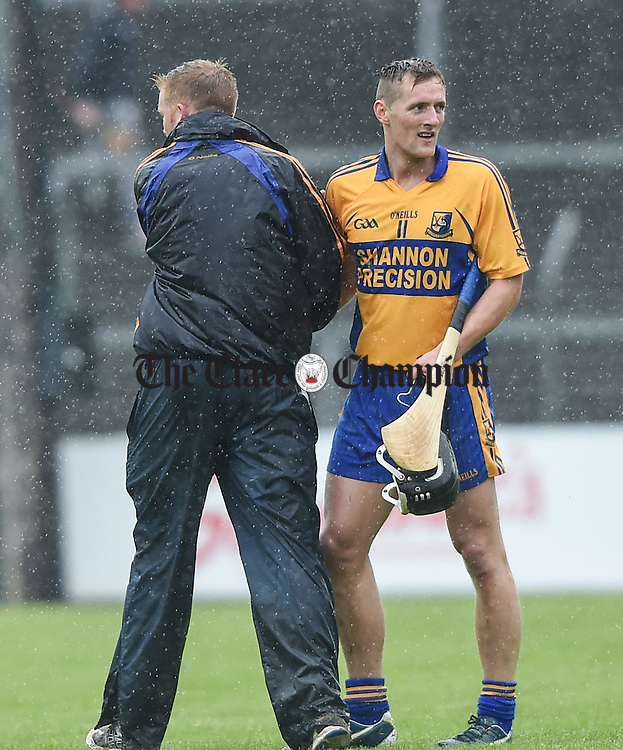 Shane Golden of Sixmilebridge is congratulated by mentor Brian Culbert following their match against Eire Og in Ennis. Photograph by John Kelly.