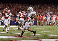 Daniel Herron of Ohio State scores a touchdown against Arkansas during 77th Annual Allstate Sugar Bowl Classic at Louisiana Superdome in New Orleans, Louisiana on January 4th, 2011.  Ohio State defeated Arkansas, 31-26.