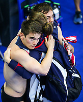 Picture by Rogan Thomson/SWpix.com - 17/07/2017 - Diving - Fina World Championships 2017 -  Duna Arena, Budapest, Hungary - Dan Goodfellow and Tom Daley of Great Britain are consoled  after they fail to medal in the Men's 10m Synchro Platform Final.