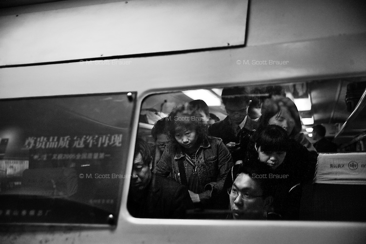 Travelers exit a train car in Hefei, Anhui, China.