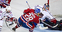 April 28, 2007; Hamilton, ON, CAN; Hamilton Bulldogs goalie (29) Carey Price blocks a shot on goal by Rochester Americans centre (28) Kamil Kreps as Bulldogs defenceman (27) Danny Groulx moves in during game six of the AHL north division semifinal at Copps Coliseum. The Bulldogs won 6-2 and eliminated the Americans from the playoffs. Mandatory Credit: Ron Scheffler, Special to the Spectator. (File number RRSA8145).
