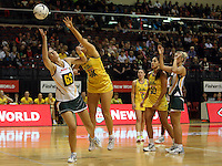 25.10.2012 Australia's Bianca Chatfield and South Africa's Chrisna Bootha in action during the England v Australia netball test match as part of the Quad Series played at the TSB Arena Wellington. Mandatory Photo Credit ©Michael Bradley.