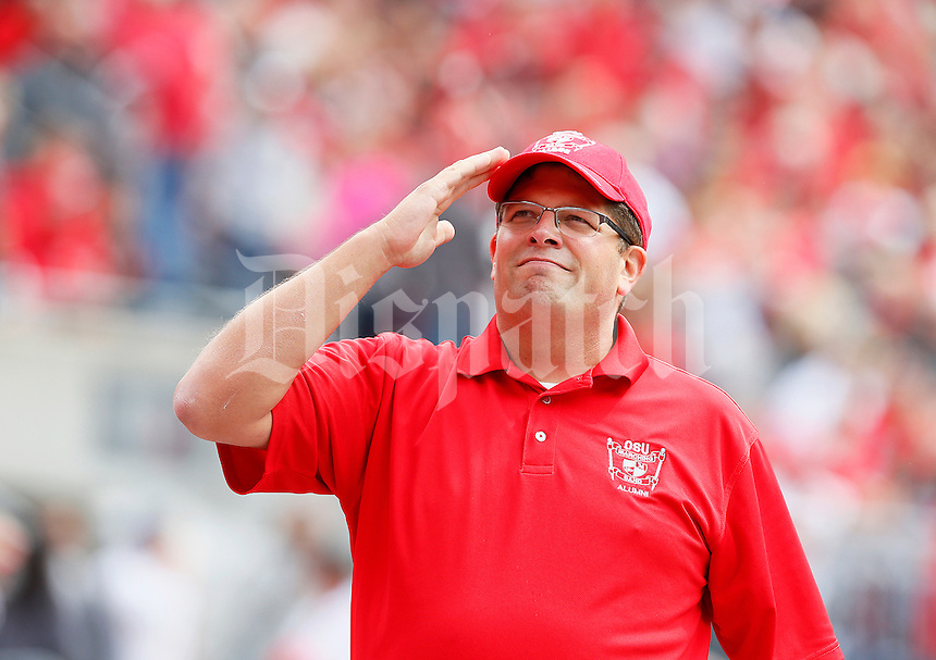 Former Ohio State marching band director Jonathan Waters thanks the crowd for its support after conducting several songs during the game against Kent State, at Ohio Stadium in Columbus, Saturday, September 13, 2014. (Dispatch Photo by Jenna Watson)