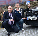 First Minister Alex Salmond is asked by oil worker Martin Wilkie, 41, to pose with his BMW for a photo.