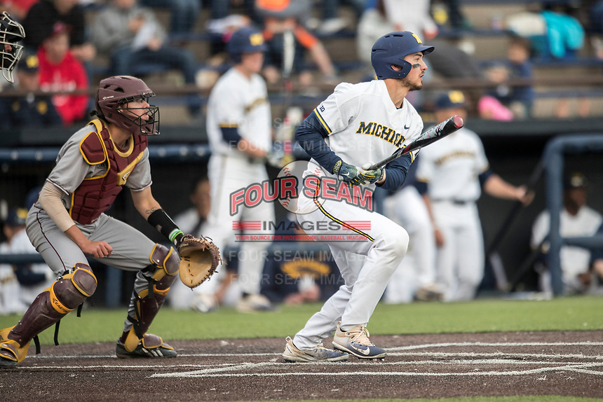 Michigan Wolverines catcher Drew Lugbauer (17) follows through on his swing against the Central Michigan Chippewas on May 9, 2017 at Ray Fisher Stadium in Ann Arbor, Michigan. Michigan defeated Central Michigan 4-2. (Andrew Woolley/Four Seam Images)