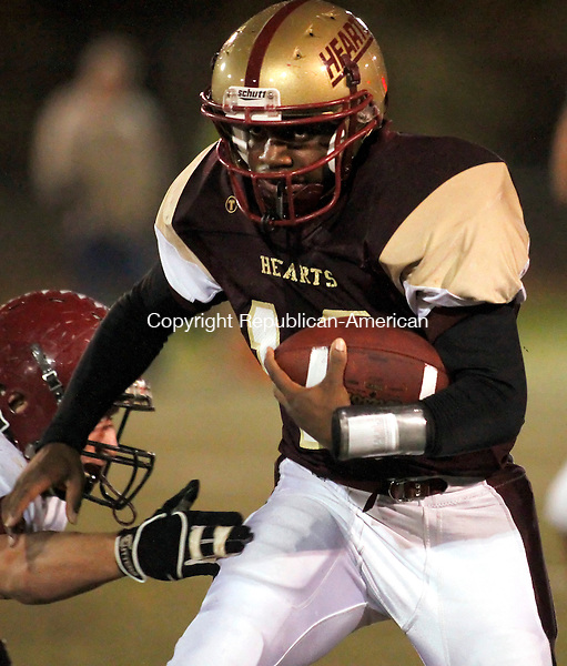 Waterbury, CT- 04, November 2010-110410CM13 News action man Sacred Heart's Quarterback Rohan Ifill carries the ball during the Heart's 42-27 win over Torrington Thursday night at Municipal Stadium in Waterbury. Christopher Massa Republican-American