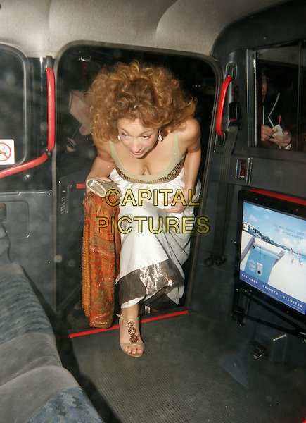 ALEX KINGSTON.Laurence Olivier Awards at the London Hilton, Park Lane, London, UK..Ref: SW.full length car cab cleavage.www.capitalpictures.com.sales@capitalpictures.com.©Capital Pictures.