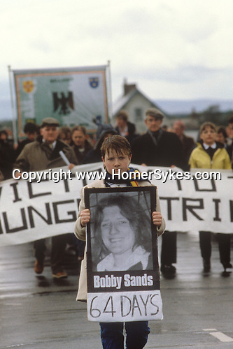 Ireland The Troubles. Belfast 1980s. Catholic supporters of the Hunger Strike, march woman carrying image of Bobby Sands who has been 64 days on Hunger Strike.