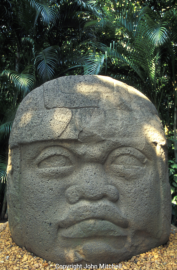 Colossal Olmec head, Monument 1 at the Parque Museo Laventa in Villahermosa, Tabasco. Mexico. This outdoor archaeology museum and ecological park was created by Mexican poet Carlos Pellicer in 1957.