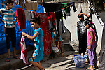 29/08/15. Shaqlawa, Iraq. -- Displaced children from Falluja hang their washing on ropes outside the basement  where they have been living for the past year and a half. <br /> 11 families live in the building, each of them using a 3 by 4 meters' room for which they pay 300.000 IQD (250usd).