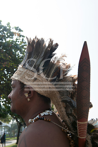 Antonio da Silva, a Crateús Indian from the state of Ceara, Brazil wears his feather headdress and carries his borduna warcluo at the People's Summit, United Nations Conference on Sustainable Development (Rio+20), Rio de Janeiro, Brazil, 15th June 2012. Photo © Sue Cunningham.