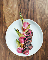 Concourse Restaurant Moderne in Denver, Colorado, Thursday, September 7, 2017. Foods photographed include the Duroc pork loin with black Venetian rice, fava beans and Pueblo chili powder as well as the hanger steak with almond Romesco, romaine hearts, and sweet & sour red onion.<br /> <br /> Photo by Matt Nager