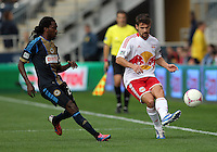 CHESTER, PA - OCTOBER 27, 2012:  Keon Daniel (26) of the Philadelphia Union can't stop a pass by  Heath Pearce (3) of the New York Red Bulls during an MLS match at PPL Park in Chester, PA. on October 27. Red Bulls won 3-0.