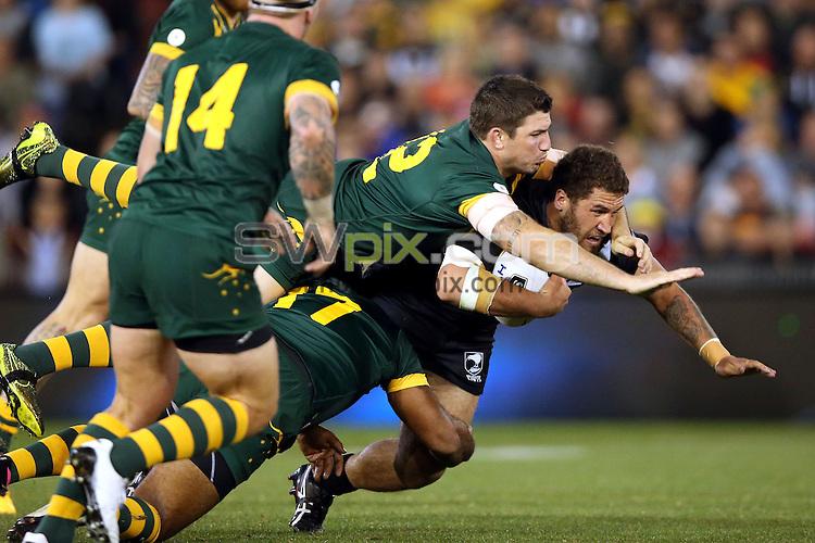 Kenny Bromwich tackled by Matt Gillett<br /> Trans Tasman NZRL Kiwis v Australia Test Match at Hunter Stadium, Newcastle, Australia. Friday 6 May 2016. Photo: Paul Seiser / www.photosport.nz / SWpix.com