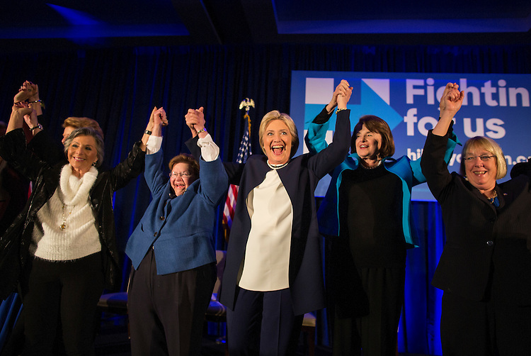 UNITED STATES - NOVEMBER 30 - Democratic Presidential Candidate Hillary Clinton thanks the crowd as she holds hands with Democratic Women Senators, from left, Sen. Barbara Boxer, D-Calif., Sen. Barbara Mikulski, D-Md., Sen. Dianne Feinstein, D-Calif., and Sen. Patty Murray, D-Wash., at a Women Senators Endorsement Event for Democratic Presidential Candidate Hillary Clinton at the Hyatt Regency on Capitol Hill, in Washington, Monday, November 30, 2015. (Photo By Al Drago/CQ Roll Call)