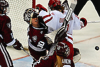 "5'9"" Badger freshman Meghan Duggan battles it out with the Harvard goalie Saturday night at the Kohl Center"