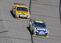 Sept. 28, 2008; Kansas City, KS, USA; Nascar Sprint Cup Series driver Jimmie Johnson (48) leads Matt Kenseth (17) during the Camping World RV 400 at Kansas Speedway. Mandatory Credit: Mark J. Rebilas-