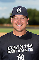 GCL Yankees 1 pitcher Sean Carley (14) poses for a photo after the second game of a doubleheader against the GCL Braves on July 1, 2014 at the Yankees Minor League Complex in Tampa, Florida.  GCL Braves defeated the GCL Yankees 1 by a score of 3-1.  (Mike Janes/Four Seam Images)