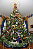 The Official White House Christmas tree is displayed in the Blue Room of the White House in Washington, DC.  The tree features holiday cards created by military children.  Medals, badges, and patches from all of the military branches are displayed on ornaments.  The theme for the White House Christmas 2011 is Shine, Give, Share - celebrating the countless ways we can lift up those around us, put our best self forward in the spirit of the season, spend time with friends and family, celebrate the joy of giving to others, and share our blessings with all.  The theme translates to the holiday décor on several levels. There is the literal translation through the use of shiny elements – star motifs, quartz and metallics like copper, aluminum and mirrored paper. There is also a conceptual connection – we're inviting visitors to give their thanks to members of our military, and have once again invited guest artists to share their talents working with the White House. This year's décor also includes handmade decorations crafted from simple materials – paper, felt, and even recycled cans. These are projects that anyone can do at home using readily available materials that are inexpensive or free..Credit: Ron Sachs / CNP