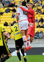 Keegan Smith (right) defends his goal during the A-League football match between Wellington Phoenix and Adelaide United FC at Westpac Stadium in Wellington, New Zealand on Sunday, 8 October 2017. Photo: Dave Lintott / lintottphoto.co.nz