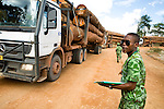 National Park guard checking logging trucks for legal harvest, Lope National Park, Gabon