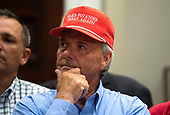 A farmer wears a United States President Donald J. Trump themed hat listens as he delivers remarks on supporting American farmers, in the Roosevelt Room at the White House in Washington, D.C. on May 23, 2019. Trump announced a $16 Billion in aid to farmers and also spoke on China tariffs, Iran and his relations with Congressional Democrats.  <br /> Credit: Kevin Dietsch / Pool via CNP