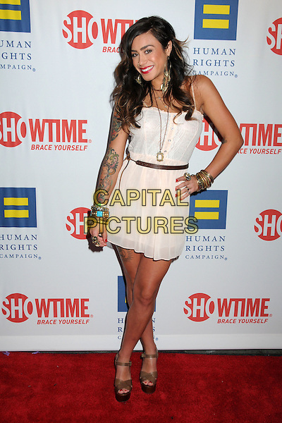 "SARA BETTENCOURT.Premiere of Showtime's New Reality Series ""The Real L Word""  Held At East West Lounge, West Hollywood, California, USA..June 1st, 2011.full length white dress tattoos hand on hip brown belt shoes .CAP/ADM/BP.©Byron Purvis/AdMedia/Capital Pictures."