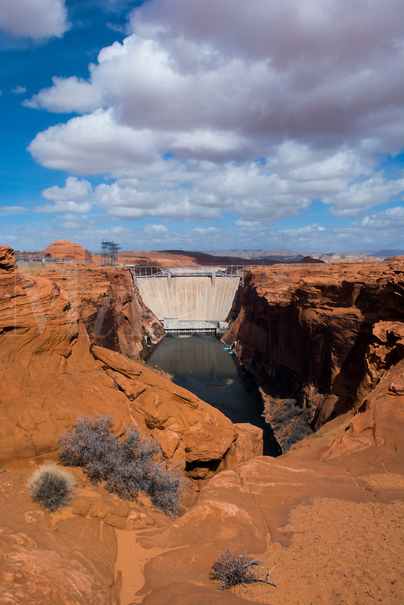 Page Arizona Glen Canyon Dam on Colorado River scenics with rocks and clouds for tourists West USA from above