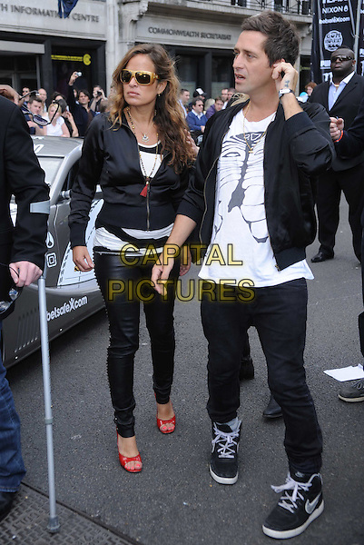 JADE JAGGER.The 2010 Gumball 3000 Rally, London, England..May 1st, 2010.full length black jacket trousers red wedges shoes sunglasses shades leather profile.CAP/DS.©Dudley Smith/Capital Pictures