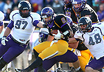 MANKATO, MN - NOVEMBER 1:  Jarrett Grabbe #97, Grant Schindler #57 and Carter Ahlers #48 for the University of Sioux Falls bring down Nick Pieruccini #6 from Minnesota State Mankato in the second quarter Saturday afternoon at Blakeslee Stadium in Mankato. (Photo by Dave Eggen/Inertia)