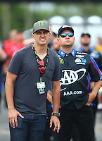 May 1, 2016; Baytown, TX, USA; Graham Rahal (left) and Robert Hight watch as NHRA funny car driver Courtney Force races in the final round of the Spring Nationals at Royal Purple Raceway. Mandatory Credit: Mark J. Rebilas-USA TODAY Sports