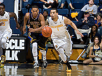Justin Cobbs of California dribbles the ball during the game against Coppin State at Haas Pavilion in Berkeley, California on November 8th, 2013.    California defeated Coppin State, 83-64.