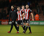 George Baldock of Sheffield Utd receives a hug from Jake Wright of Sheffield Utd  during the Championship match at Bramall Lane Stadium, Sheffield. Picture date 26th December 2017. Picture credit should read: Simon Bellis/Sportimage