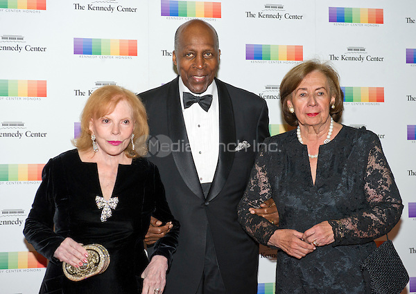 Buffy Cafritz, Vernon Jordan, and Ann Jordan arrive for the formal Artist's Dinner honoring the recipients of the 38th Annual Kennedy Center Honors hosted by United States Secretary of State John F. Kerry at the U.S. Department of State in Washington, D.C. on Saturday, December 5, 2015. The 2015 honorees are: singer-songwriter Carole King, filmmaker George Lucas, actress and singer Rita Moreno, conductor Seiji Ozawa, and actress and Broadway star Cicely Tyson.<br /> Credit: Ron Sachs / Pool via CNP/MediaPunch