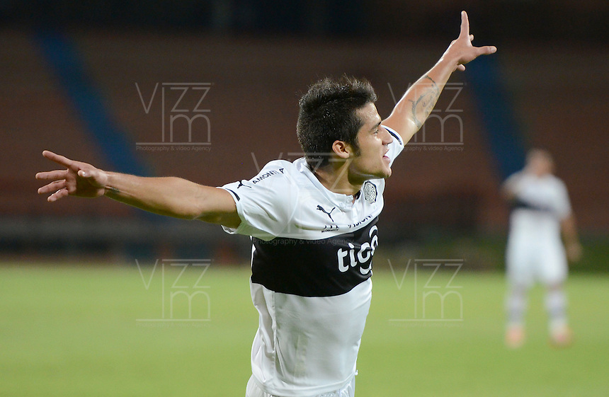 MEDELLIN - COLOMBIA-15-09-2015: Ivan Torres jugador de Olympia (PRY) celebra el segundo gol anotado a Aguilas Doradas (COL) durante partido de vuelta por la segunda fase de la Copa Sudamericana 2015 jugado en el estadio Atanasio Girardot de la ciudad de Medellín./  Ivan Torres player of Olimpia (PRY) celebrates the second goal scored to Aguilas Doradas (COL) during second leg match of the second phase of Sudamerica Cup 2015 played at Atanasio Giraardot stadium in Medellin city.  Photo:VizzorImage/ Leon Monsalve /Str