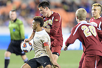 Houston, TX - Friday December 9, 2016: Jacori Hayes (8) of the Wake Forest Demon Deacons and Sam Hamilton (8)  of the Denver Pioneers battle for control of a loose ball at the NCAA Men's Soccer Semifinals at BBVA Compass Stadium in Houston Texas.