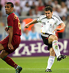 08 July 2006: Miroslav Klose (GER) (11) follows through on a shot as Costinha (POR) (6) follows the flight of the ball with his eyes. Germany defeated Portugal 3-1 at the Gottlieb-Daimler Stadion in Stuttgart, Germany in match 63, the third-place game, of the 2006 FIFA World Cup.