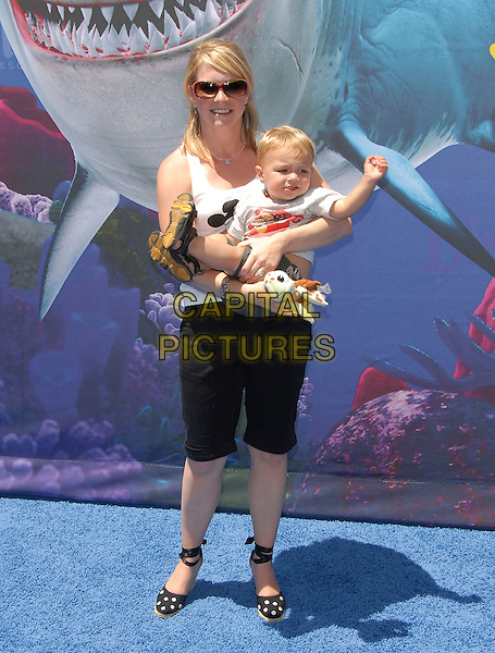 MELISSA JOAN HART & SON.attends The Finding Nemo Submarine Voyage Celebrity Preview held in Tomorrowland at Disneyland in Anaheim, California, USA, June 10 2007                                                                     full length mickey mouse white vest top child black shorts wedges.CAP/DVS.©Debbie VanStory/Capital Pictures