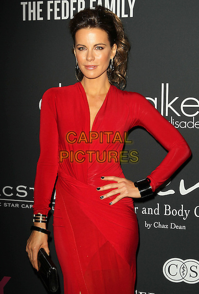 Kate Beckinsale<br /> The Pink Party 2013 held at the Santa Monica Airport, Santa Monica, California, USA.<br /> October 19th, 2013<br /> half length dress red black  wrap slit split hand on hip clutch bag cuff bracelet  <br /> CAP/ADM/KB<br /> &copy;Kevan Brooks/AdMedia/Capital Pictures
