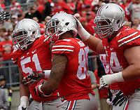 Ohio State Buckeyes tight end Marcus Baugh (85) celebrates scoring a touchdown with Ohio State Buckeyes offensive linesman Joel Hale (51) and Ohio State Buckeyes offensive linesman Billy Price (54) during Saturday's NCAA Division I football game at Ohio Stadium in Columbus on September 13, 2014. (Dispatch Photo by Barbara J. Perenic)