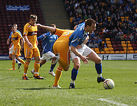 Alan Maybury gets the better of Stevie Hammell in the Motherwell v St Johnstone Clydesdale Bank Scottish Premier League match played at Fir Park, Motherwell on 28.4.12.