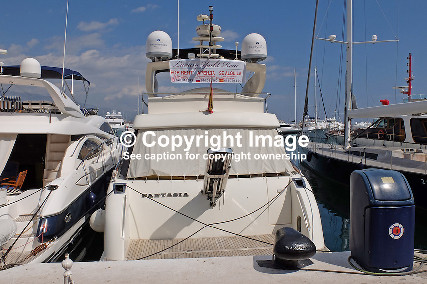 Rental signage on luxury cruisers, yachts, etc, at Puerto Banus, Marbella, Spain is now usually in three languages, English and Russian as well as Spanish. March 2015. 201503160606<br /> <br /> Copyright Image from Victor Patterson, 54 Dorchester Park, Belfast, UK, BT9 6RJ<br /> <br /> t: +44 28 9066 1296<br /> m: +44 7802 353836<br /> vm +44 20 8816 7153<br /> <br /> e1: victorpatterson@me.com<br /> e2: victorpatterson@gmail.com<br /> <br /> www.victorpatterson.com<br /> <br /> IMPORTANT: Please see my Terms and Conditions of Use at www.victorpatterson.com