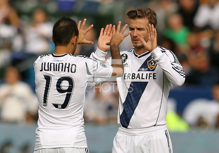 CARSON, CA - DECEMBER 01, 2012:   Juninho (19) and  David Beckham (23) of the Los Angeles Galaxy against the Houston Dynamo during the 2012 MLS Cup at the Home Depot Center, in Carson, California on December 01, 2012. The Galaxy won 3-1.