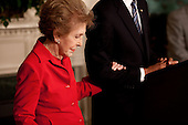 Washington, DC - June 2, 2009 -- Former First Lady Nancy Reagan embraces President Barack Obama's arm at the podium as he announces and signs the Ronald Reagan Centennial Commission Act in the Diplomatic Room of the White House, June 2, 2009..Mandatory Credit: Pete Souza - White House via CNP