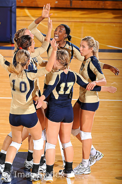 11 September 2011:  FIU's team (pictured, Una Trkulja (7), Andrea Lakovic (1), Marija Prsa (10), Carolyn Fouts (17), Jovana Bjelica (16) and Renele Forde (14)) celebrates winning a key point in the second set as the FIU Golden Panthers defeated the Florida A&M University Rattlers, 3-0 (25-10, 25-23, 26-24), at U.S Century Bank Arena in Miami, Florida.
