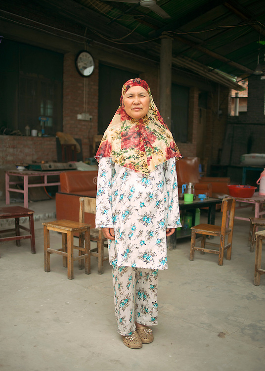 China / Henan Province / Luoyang / Mapo village / 24.6.2013 / Ding Xiangzhen, the Imam&rsquo;s daughter and Lan&rsquo;s aunt, poses for a portrait in the yard of her house, where she organizes a Koranic school during the summer.<br />