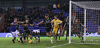 Oldham Athletic's Peter Clarke (left) attempts to have a shot goal despite the attentions of Bristol Rovers' Ollie Clarke (c) during the Sky Bet League 1 match between Oldham Athletic and Bristol Rovers at Boundary Park, Oldham, England on 30 December 2017. Photo by Juel Miah / PRiME Media Images.