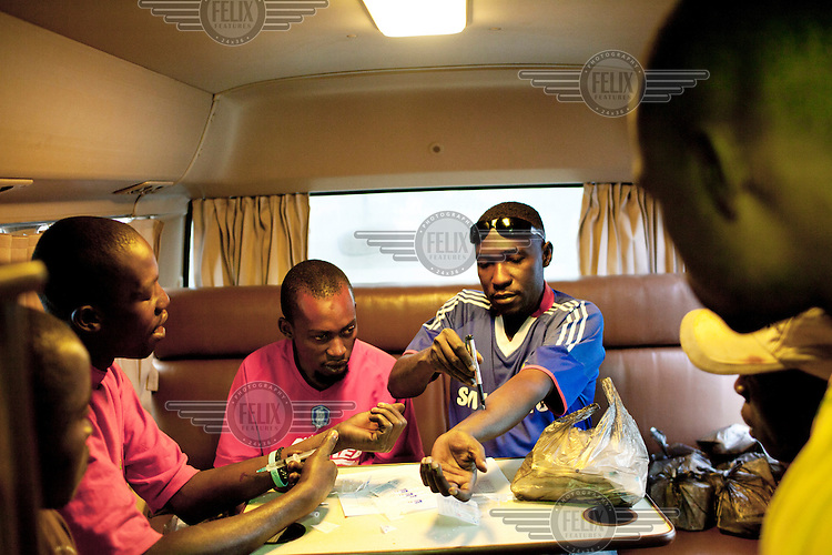A social worker teaches injecting drug users about safe injection and distributes safe injection kits in the MDM (Medecins du Monde) bus in Dar Es Salaam.
